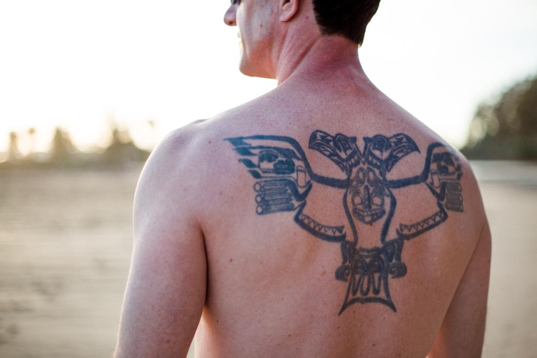 Portrait of a man with a tattoo at Goleta Beach in Santa Barbara.