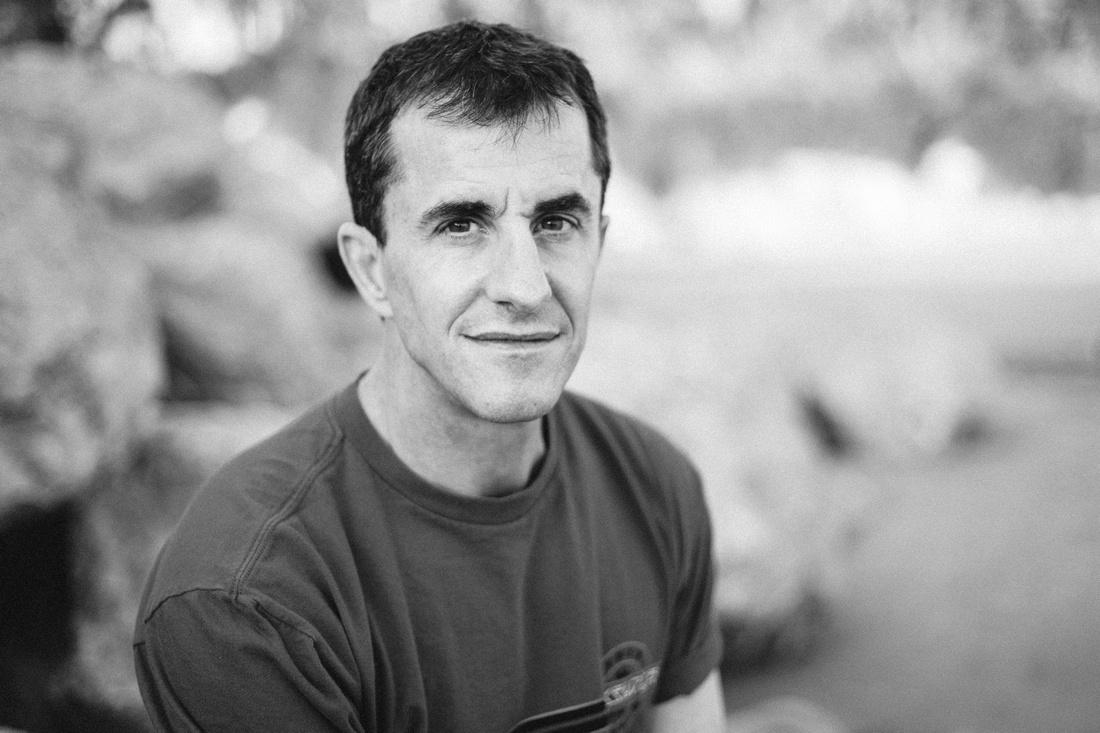 Black and white portrait of a handsome man at Goleta Beach in Santa Barbara.