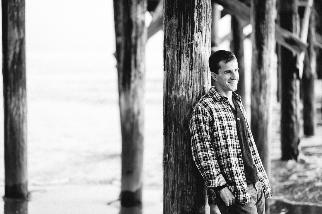 Black and white portrait of a man at Goleta Pier in Santa Barbara.