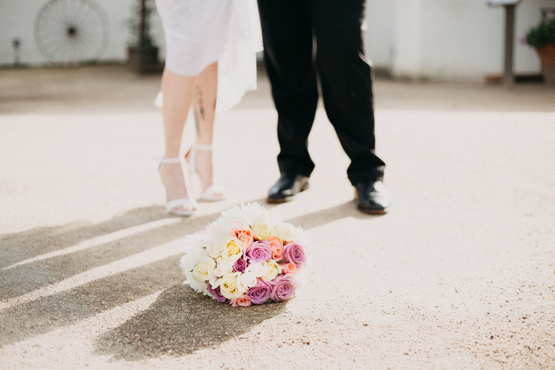 Wedding bouquet, couple's feet and rustic, Western-feeling surroundings in Ventura, California