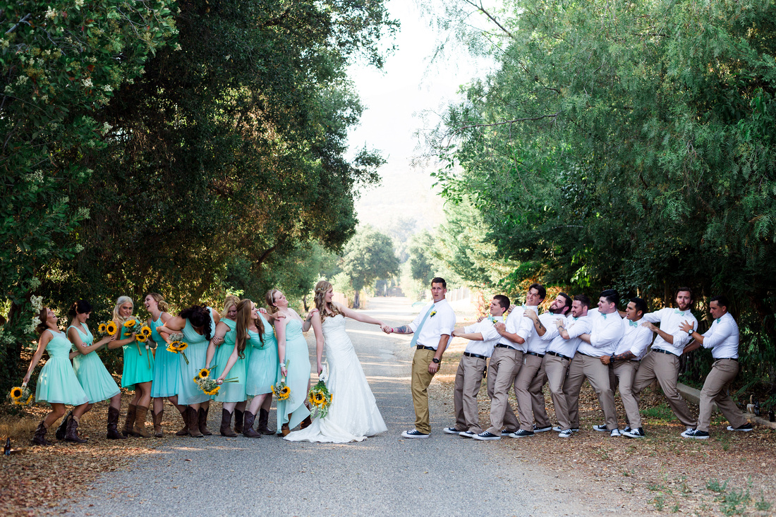 Wedding party tag of war at rustic chic Summer wedding in Ojai, California, shot by Alison Photography.