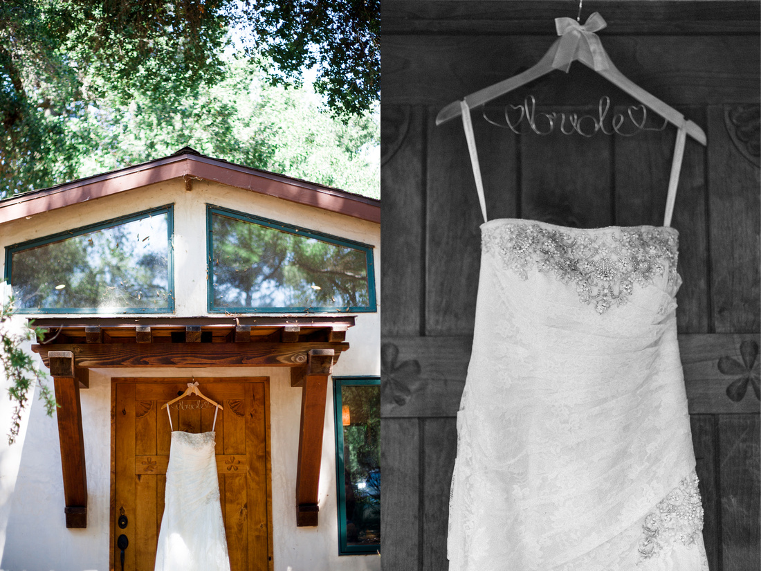 Wedding dress hanging on the door to a sweet little cabin in nature shot by Alison Photography.