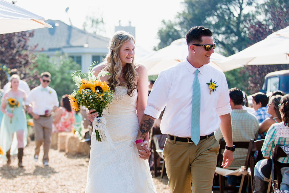 Bride and groom leading the recessional at rustic chic wedding ceremony in Ojai, California, shot by Alison Photography.