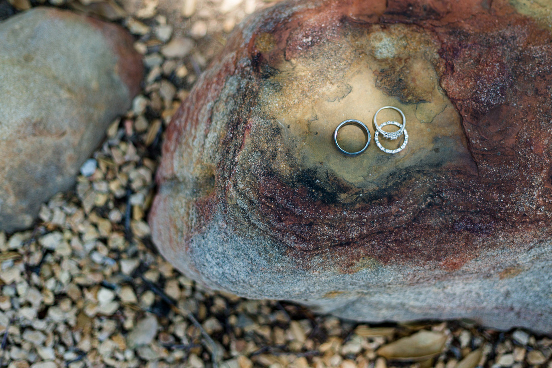 Wedding rings on a colorful rock in Ojai, California, shot by Alison Photography.