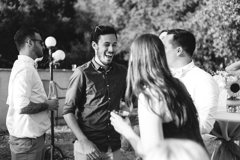 Guests having fun at rustic chic Summer wedding reception in Ojai, California, shot by Alison Photography.