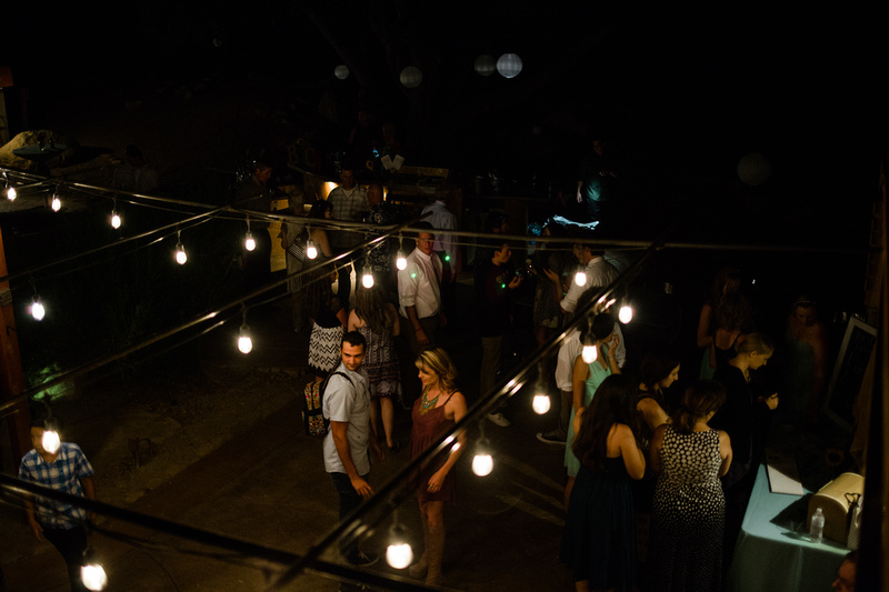 Guests and string bistro lights at rustic chic Summer wedding reception in Ojai, California, shot by Alison Photography.