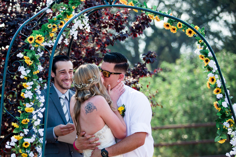 Couple kissing during wedding ceremony at a private home in Ojai shot by Alison Photography.