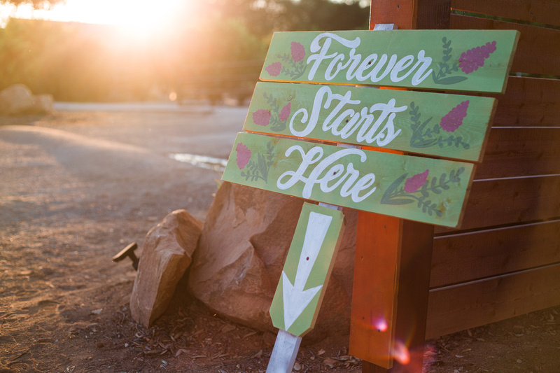 """Forever starts here"" sign at rustic chic Summer wedding reception in Ojai, California, shot by Alison Photography."